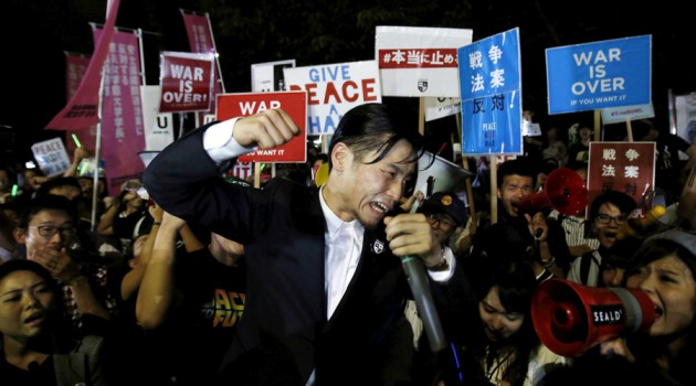 Okuda, founding member of the protest group Students Emergency Action for Liberal Democracy, shouts slogans during a rally against Japan's Prime Minister Shinzo Abe's security bill and his administration in front of the parliament in Tokyo