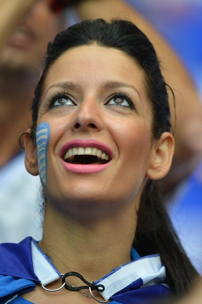 A Greek fan cheers before the Euro 2012