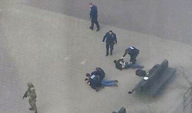 32739A9B00000578-3504151-Drama_Two_men_were_pinned_to_the_ground_by_armed_police_and_spec-a-12_1458661653503