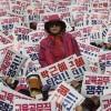 【緊急】韓国100万人デモで日本語の旗が振られている件