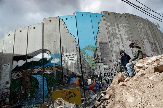 0x0-the-walled-off-hotel-artist-banksy-opens-hotel-on-bethlehem-apartheid-wall-1488560596570