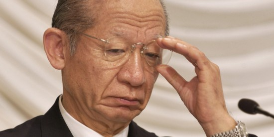 Toshiba Corp. Chairman Taizo Nishimuro adjusts his glasses a